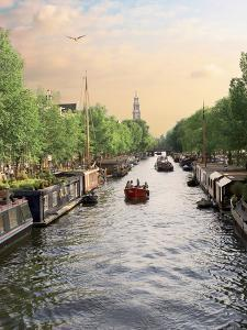 Boats Cruise Along a Canal with the Zuiderkerk Bell-Tower in the Background, Amsterdam, Netherlands by Miva Stock