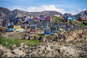 Greenland, Qeqertarsuaq. Godhavn village harbor, Disko Island, colorful houses by Miva Stock