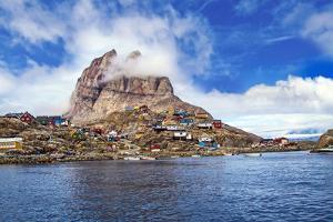 Greenland, Uummannaq. Uummannaq mountain (1170 m, 3839 ft) looms over the fishing village of Uumman by Miva Stock