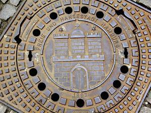 Manhole Cover with Hamburg's Coat of Arms, Hamburg, Germany by Miva Stock