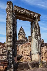 Siem Reap, Cambodia. Ancient doorway still standing through which the spires and statues atop of th by Miva Stock