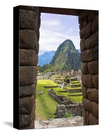 View Through Window of Ancient Lost City of Inca, Machu Picchu, Peru, South America with Llamas