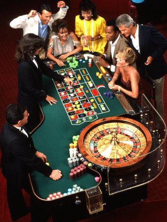 https://imgc.artprintimages.com/img/print/mixed-ethnic-couples-enjoying-themselves-in-a-casino_u-l-p2seoa0.jpg?p=0