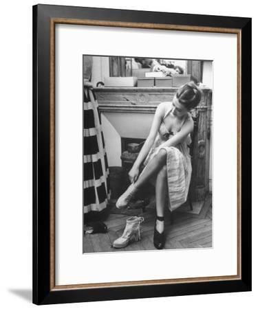 Model Changing Her Shoes For Pierre Balmain's Fashion Show-Nina Leen-Framed Premium Photographic Print