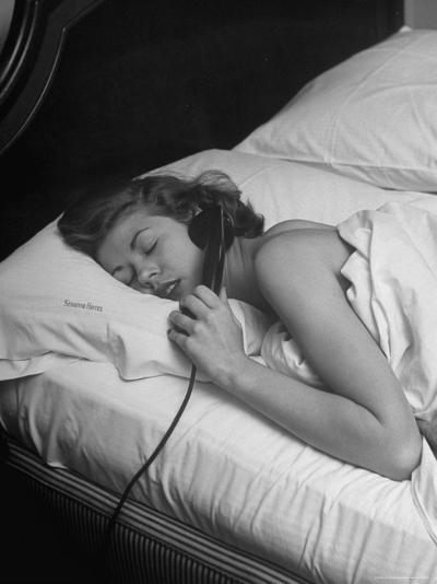 Model Gaby Bouche Talking on the Phone from Her Hotel Room-Nina Leen-Photographic Print