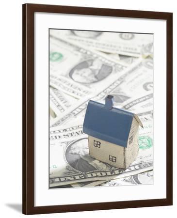 Model House on Pile of American Dollar Bills--Framed Photographic Print