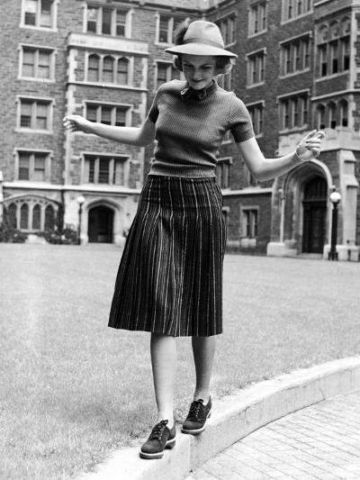 Model in Hat, Sweater and Skirt, Appearing to Balance on Curb, c.1938-Alfred Eisenstaedt-Photographic Print