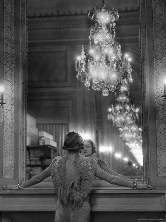 https://imgc.artprintimages.com/img/print/model-in-ostrich-feather-trimmed-gown-pausing-to-regard-herself-in-grand-mirror-of-molyneux-atelier_u-l-p443xj0.jpg?p=0
