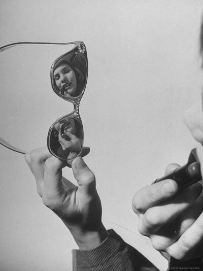 Model Lilly Fernandez Using Sunglasses as a Mirror-Martha Holmes-Photographic Print