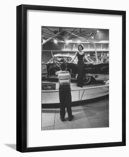 Model Posing Beside Cadillac Eldorado Captures Attention of Young Boy at National Automobile Show-Walter Sanders-Framed Photographic Print