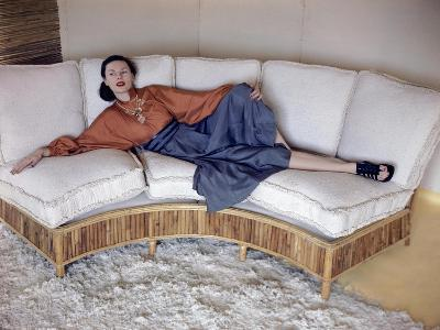 Model Reclining on Bamboo Couch--Premium Photographic Print