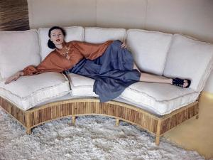 Model Reclining on Bamboo Couch