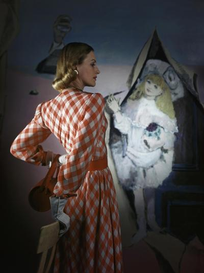Model Standing before a Mural by Vertes Wearing a Red and White Lattice-Checked Rayon Crepe Dress--Premium Photographic Print