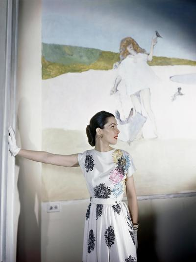 Model Standing before Mural by Vertes Wearing Floral Print on White Rayon Crepe Dress--Premium Photographic Print