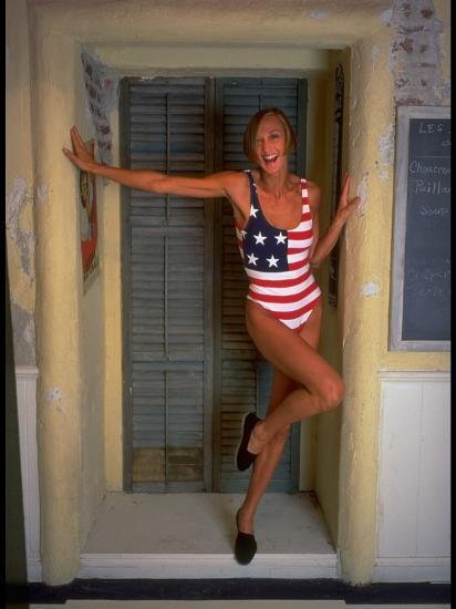 Model Standing in Doorway Modeling Ralph Lauren's Cotton and Lycra One Piece Flag Bathing Suit-Ted Thai-Photographic Print