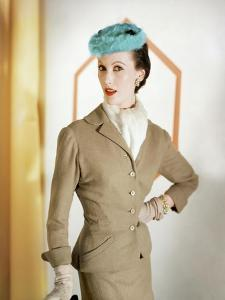 Model Wearing a Camel Wool Suit by Mollie Parnis and a Fur Turquoise Hat by Emme