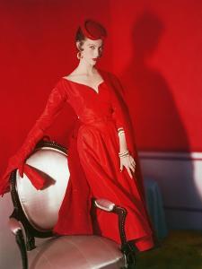 Model Wearing a Deep Rose Red Silk Dress by Nettie Rosenstein