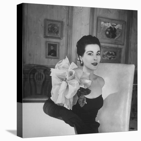 Model Wearing a Flowery Dress While Peering Into the Distance-Nina Leen-Stretched Canvas Print