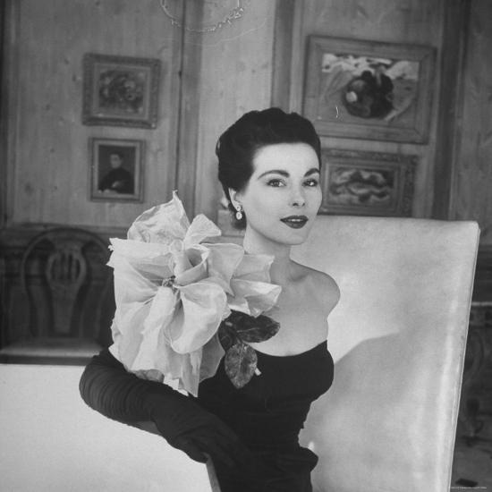Model Wearing a Flowery Dress While Peering Into the Distance-Nina Leen-Photographic Print