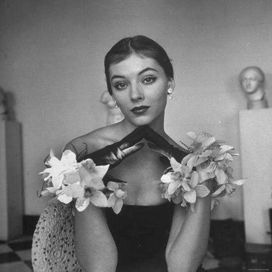Model Wearing a Flowery Glove While Peering Into the Distance-Nina Leen-Photographic Print