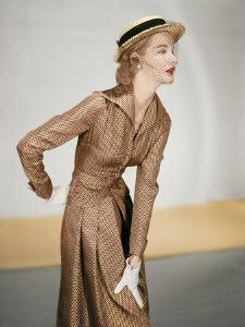 Model Wearing a Jose Martin Suit; Silk Twill in Cocoa with Black Miniature Prints