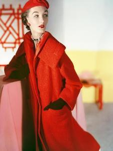 Model Wearing a Long Wool Llama Fleece Red Coat and Matching Hat by Esperanto Givenchy