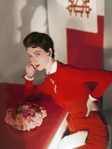 Model Wearing a Red Velvet Dress