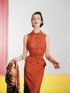 Model Wearing a Sleeveless Linen Tangerine Moygashel Black Checkered Dress