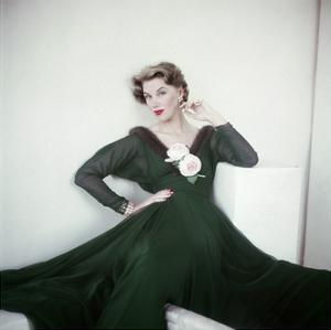 Model Wearing an Emerald Green Chiffon Dress with Ripple of Mink and Pale Pink Roses