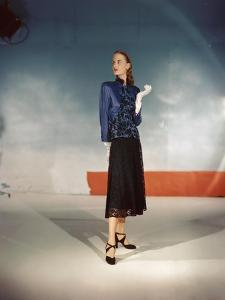 Model Wearing Black Lace Skirt and Satin and Lace Jacket from Hattie Carnegie