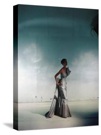 Model Wearing Gray Bustled Silk Taffeta Strapless Evening Gown from Jay Thorpe