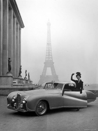 https://imgc.artprintimages.com/img/print/model-wearing-jacques-fath-ensemble-beside-1947-model-delahaye-automobile_u-l-p443ol0.jpg?artPerspective=n
