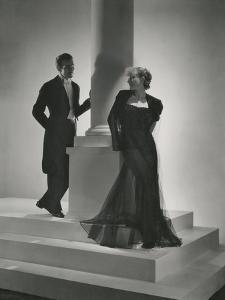 Model Wearing Long-Sleeved Sheer Black Dress over Satin Slip