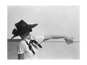 Model Wearing Shiny Dark Straw Hat with Tassel by Agnes