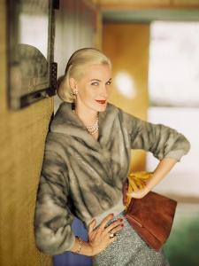 Model Wearing Short Mink Jacket with Tweed Skirt