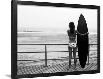 Model with Black Surfboard Standing on Boardwalk and Watching Wave on Beach-Theodore Beowulf Sheehan-Framed Photographic Print