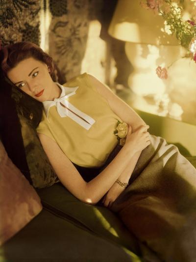 Modeling Wearing a Gold Irish Linen Sleeveless Blouse Buttoned in the Back by Sidney Heller--Premium Photographic Print