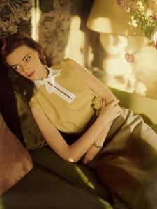 Modeling Wearing a Gold Irish Linen Sleeveless Blouse Buttoned in the Back by Sidney Heller