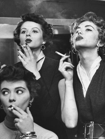 Models Exhaling Elegantly, Learning Proper Cigarette Smoking Technique in Practice For TV Ad-Peter Stackpole-Photographic Print
