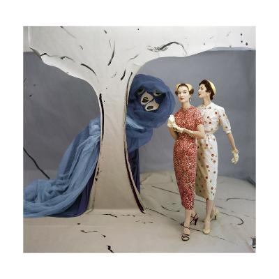 Models in Set Painted by Vertes Wearing Both Wearing Slim-Fitting Dresses by Talmack--Premium Photographic Print