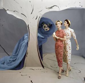 Models in Set Painted by Vertes Wearing Both Wearing Slim-Fitting Dresses by Talmack