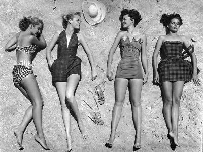 Models Lying on Beach to Display Bathing Suits-Nina Leen-Photographic Print