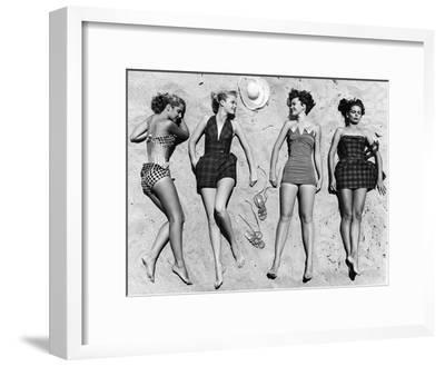 Models Sunbathing, Wearing Latest Beach Fashions-Nina Leen-Framed Premium Photographic Print