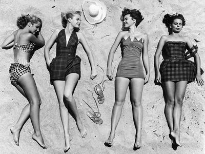 https://imgc.artprintimages.com/img/print/models-sunbathing-wearing-latest-beach-fashions_u-l-p3ocbh0.jpg?p=0