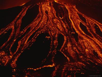 Molten Lava Flows Down a Volcanic Slope-Peter Carsten-Photographic Print