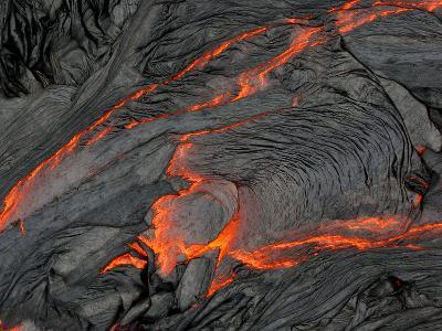 Molten Magma Glows under a Dark Crust of Hardened Lava-Patrick McFeeley-Photographic Print