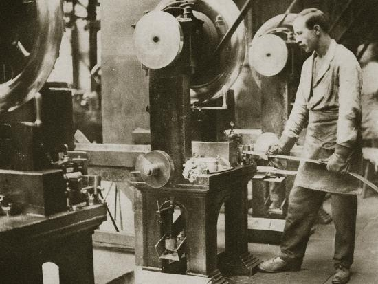 Money making; cutting strips of silver into disks, 20th century-Unknown-Photographic Print