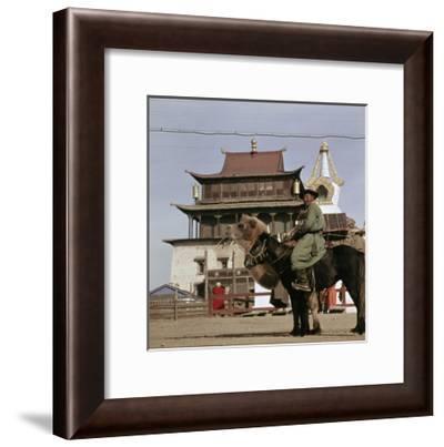 Mongolian on Horseback Transporting His Yurt on a Camel, in the Centre of Ulan Bator--Framed Giclee Print