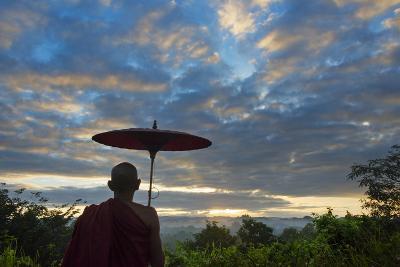 Monk watching ancient temple and pagoda at sunrise, Mrauk-U, Rakhine State, Myanmar-Keren Su-Photographic Print
