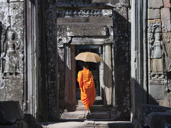 Monk with Buddhist Statues in Banteay Kdei, Cambodia-Keren Su-Photographic Print